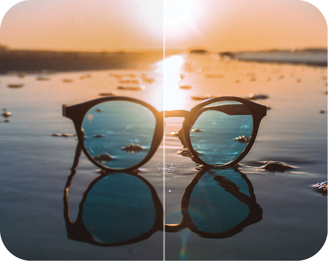 image of modern glasses laid on the sand of the beach