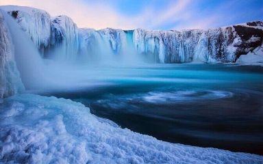 snowy frozen waterfall glacers travelguy
