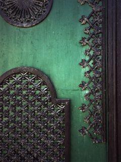 urbanexploration oldirongate ironartworkornaments greenandblack detail