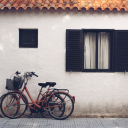 exploringthecitystreets house rooftiles windows bycicles