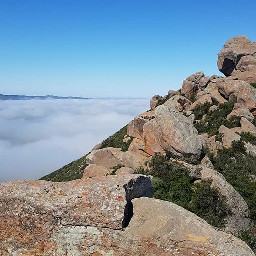 adventure hiking clouds mountain boulders