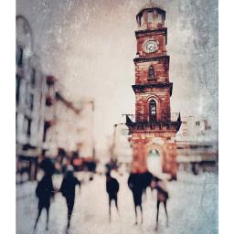 snow people clocktower blurry textured