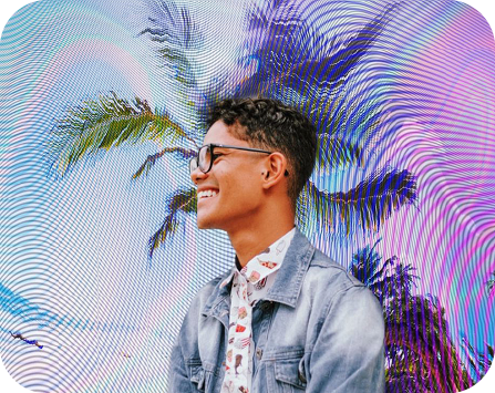 happy boy with sunglasses posing on a colorful background with a palm trees